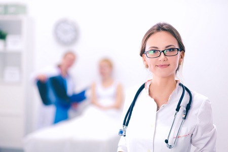Woman doctor standing at hospital with medical stethoscope