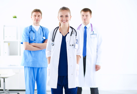 associate: Attractive female doctor in front of medical group
