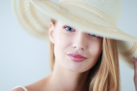 bodice: Portrait of beautiful model in hat ,isolated on white background