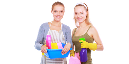 Two women is cleaning something with wisp and spray attentively. Stock Photo