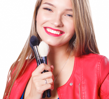 beautify: Young beautiful woman holds in hand brush for makeup Stock Photo