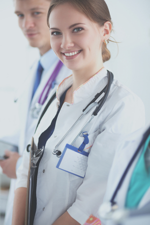 physiotherapists: Attractive female doctor in front of medical group