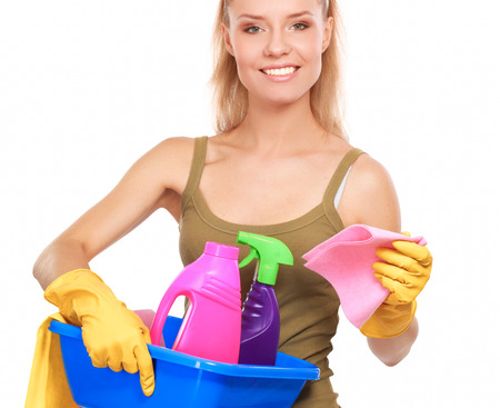 charlady: Cheerful woman is cleaning something with wisp and spray attentively. Stock Photo