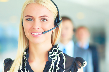 Portrait of support phone operator with the headset . Stock Photo