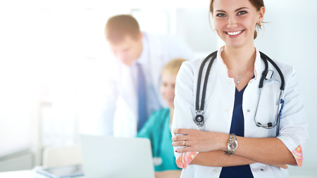Attractive female doctor in front of medical group Stock Photo - 84637324