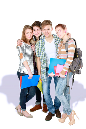 Group of happy students. Isolated over white background Stock Photo