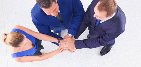 Business people shaking hands - topview .