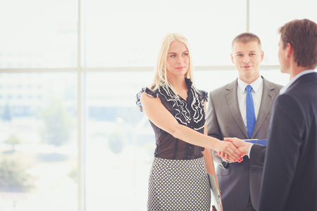 Businesswoman Shaking Hands In Office Stock fotó