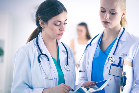 Young woman doctor holding a tablet pc . Young woman doctor. Stock Photo