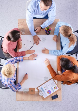 Business people sitting and discussing at business meeting, in office Stock Photo