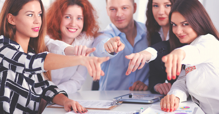 Business people sitting and pointing you, in office Stock Photo
