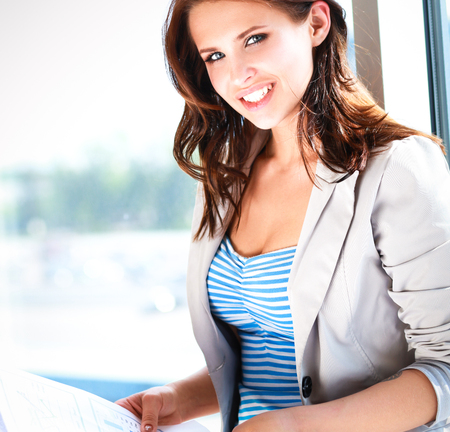 Happy businesswoman holding a paper