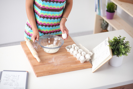 Woman is making cakes in the kitchen . Stock Photo