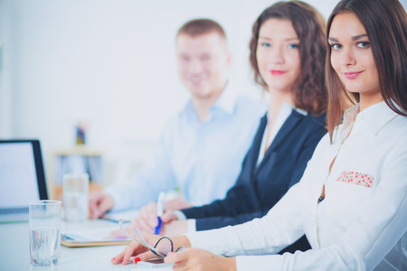 Business people sitting and discussing at business meeting, in office. Business people Stock Photo