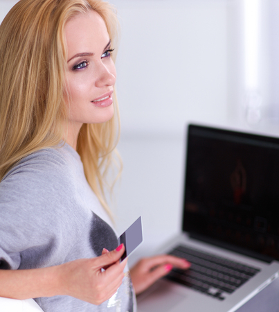 Woman shopping online with credit card and computer