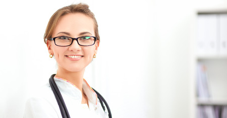 Woman doctor standingat hospital Stock Photo