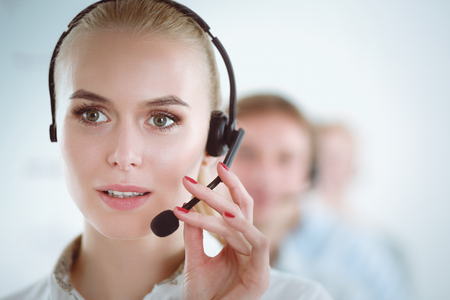 Attractive positive young businesspeople and colleagues in a call center office. Businesspeople Archivio Fotografico