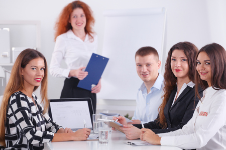 Business people sitting and discussing at business meeting, in office. Business people Stockfoto