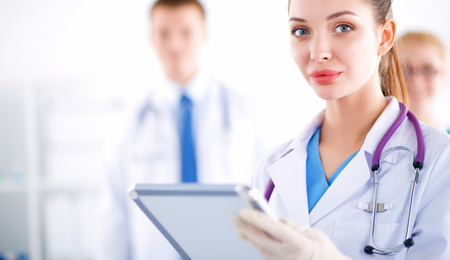 Woman doctor standing with folder at hospital Banco de Imagens