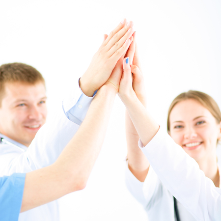 Doctors and nurses in a medical team stacking hands Archivio Fotografico - 95879752