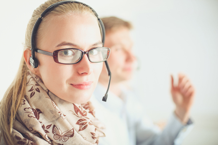 Attractive positive young businesspeople and colleagues in a call center office. Businesspeople Stock Photo