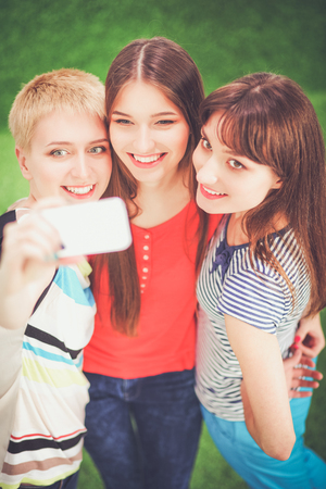 Portrait of three young women, standing together Stock Photo