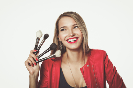 Young beautiful woman holds in hand brush for makeup . 版權商用圖片