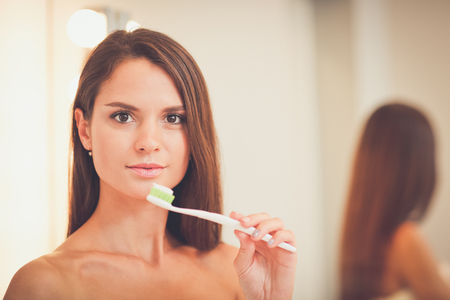 Portrait of a young girl cleaning her teeth Stock Photo