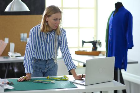 Fashion designer working on her designs in the studio Stock Photo
