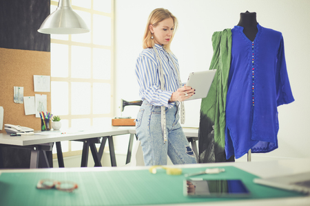 Fashion designer working on her designs in the studio Stock Photo