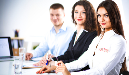 Business people sitting and discussing at meeting, in office Stock Photo