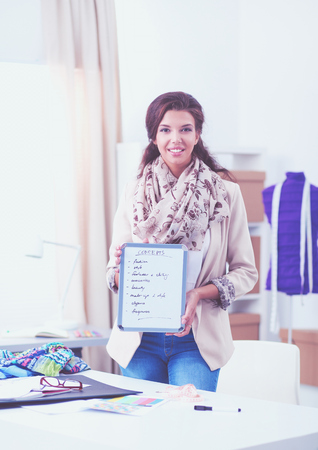 Young woman fashion designer working at studio. Stock Photo