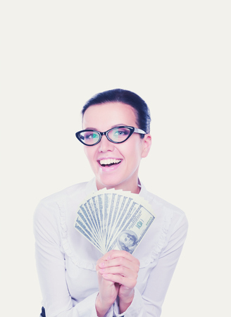 Young business woman holding money standing on white background