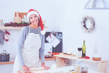 Woman making christmas cookies in the kitchen