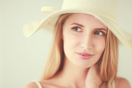 Portrait of beautiful model in hat ,isolated on white background