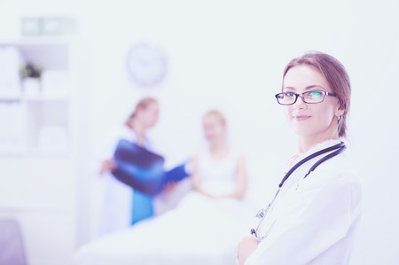 Portrait of woman doctor standing at hospital