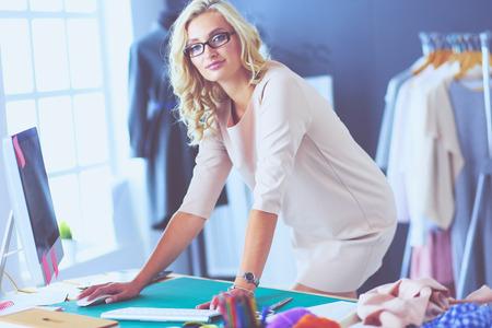 Fashion designer woman working on her designs in the studio.