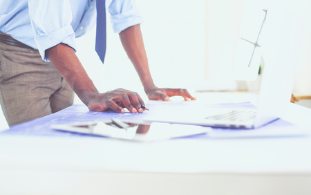 African american architect working with computer and blueprints in office Stockfoto