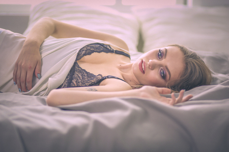 portrait sexy fashionable woman on the bed Stock Photo