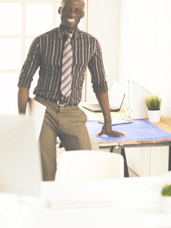 African american architect working with computer and blueprints in office Stock Photo