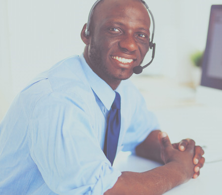 Portrait of an handsome black businessman standing in office