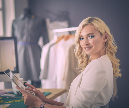 Fashion designer woman working on her designs in the studio.