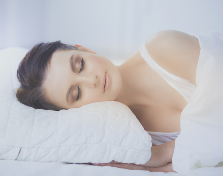 Young beautiful woman lying in bed. Stock Photo