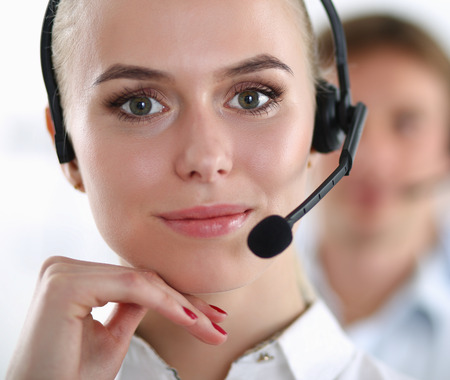 Portrait of support phone operator with the headset 스톡 콘텐츠