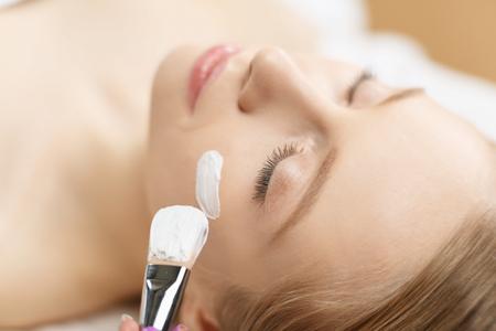 Spa facial mask application. Spa beauty organic facial mask application at day spa salon