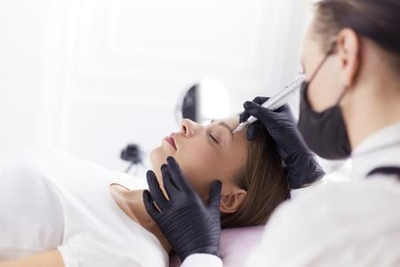 Microblading eyebrows work flow in a beauty salon. Reklamní fotografie