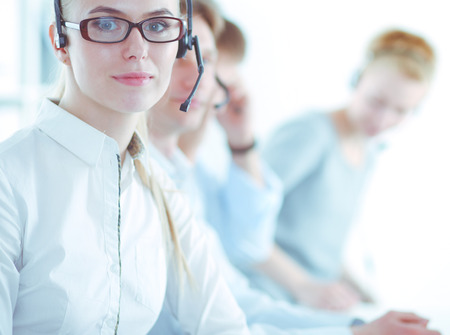 Attractive positive young businesspeople and colleagues in a call center office. Businesspeople Stok Fotoğraf