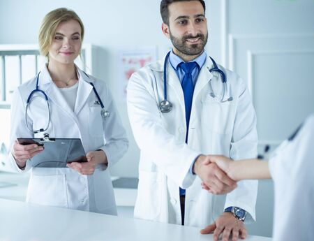 Young medical doctor people handshaking at office