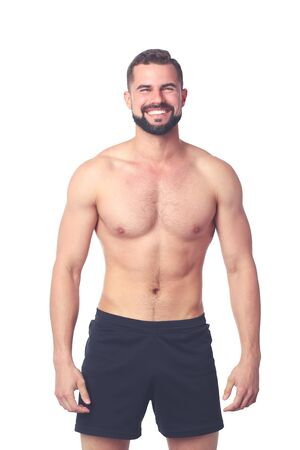 Portrait of a happy athletic man with muscular torso standing 版權商用圖片