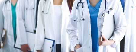 Portrait of group of smiling hospital colleagues standing together Stock Photo